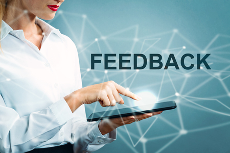 Feedback text with business woman using a tablet