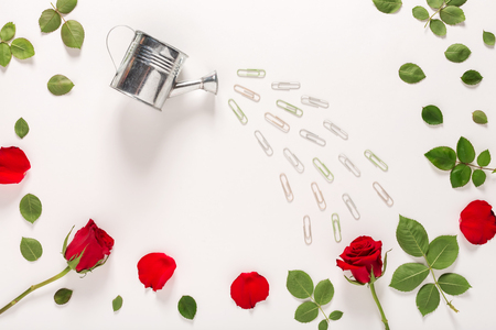 Rose blossoms and watering can craft image Imagens