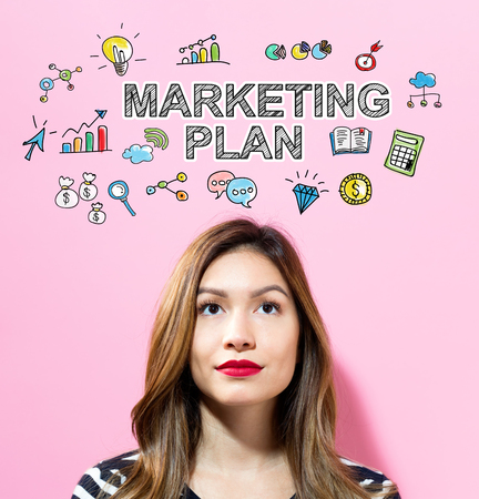 Marketing Plan text with young woman on a pink background Zdjęcie Seryjne