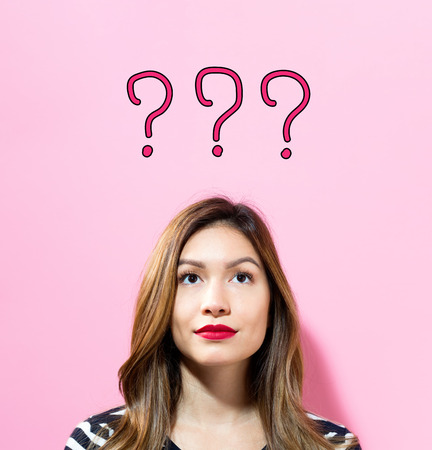 Question Mark text with young woman on a pink background