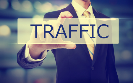 Traffic text with Businessman on blurred abstract background Stock fotó