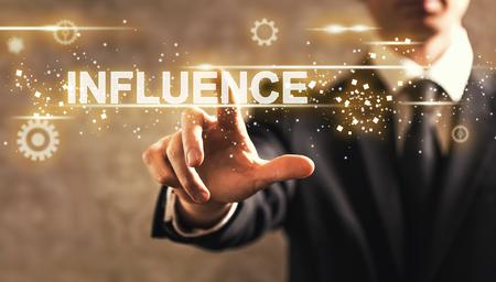 Influence text with businessman on dark vintage background