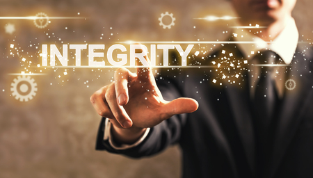 Integrity text with businessman on dark vintage background