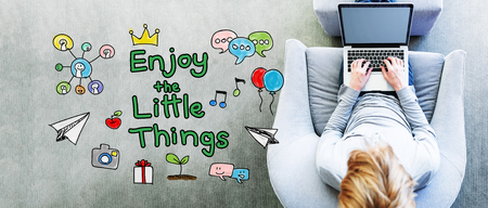 sayings: Enjoy The Little Things text with man using a laptop