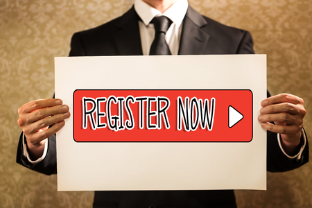 Register Now text with businessman holding a sign board