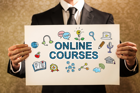 Online Courses text with businessman holding a sign board
