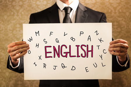 English text with businessman holding a sign board