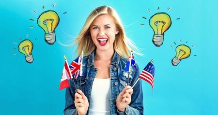 영어 사용 국가의 국기와 젊은 여자와 전구
