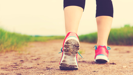 Runner going for a jog at the sand Stock Photo