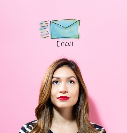Email with young woman on a pink background Stock Photo