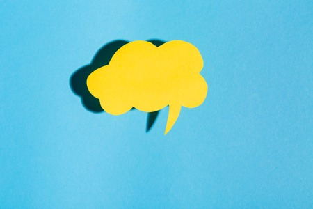 Speech bubble text message theme with hard shadow on a blue background Stock Photo