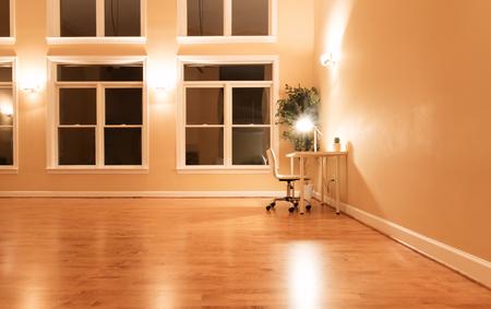 Workstation desk in a large room at night