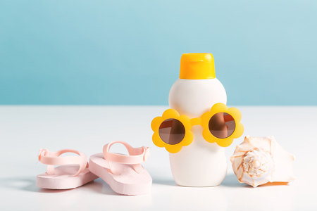 Summer accessories theme with sunblock and sunglasses