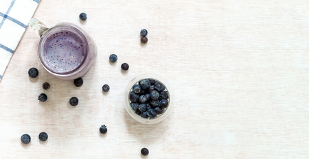 Blueberry smoothie with fresh blueberries from above