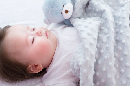 Little baby boy sleeping in his house Stock Photo - 82283576