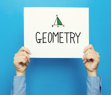 Testo geometria su un poster bianco su sfondo blu Archivio Fotografico - 82452039