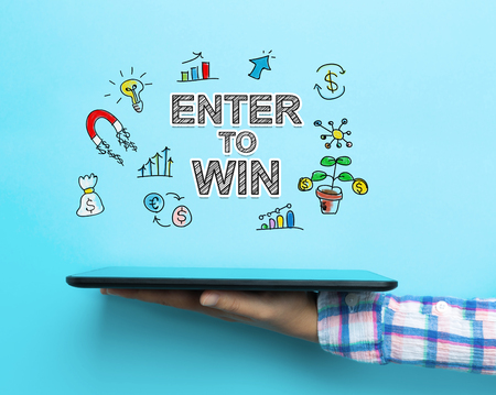 Enter to Win concept with a tablet on blue background Stock Photo