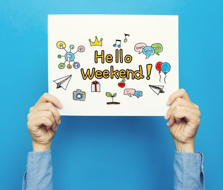 Hello Weekend text on a white poster on a blue background