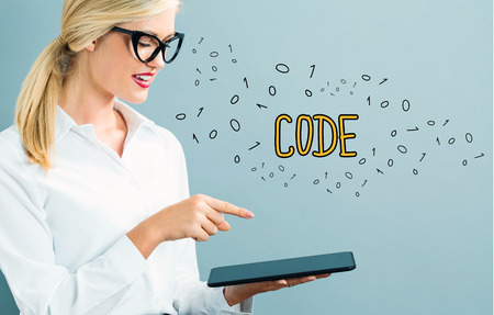 Code text with business woman using a tablet