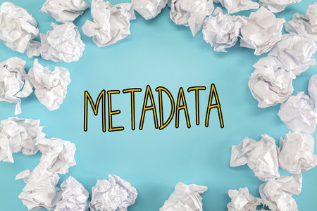 Metadata text with crumpled paper balls on a blue background