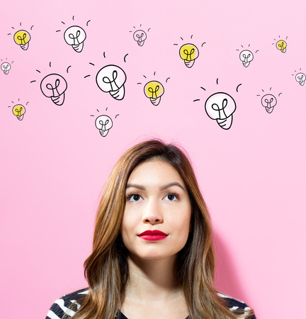 Light Bulbs with young woman on a pink background