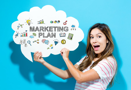 latina: Marketing Plan text with young woman holding a speech bubble on a blue background