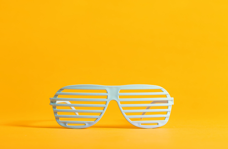 Shutter shades party glassess on a bright background Reklamní fotografie - 82673420