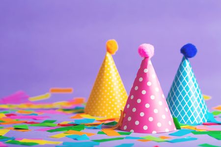 Party hat celebration theme with confetti on a bright background Stock Photo