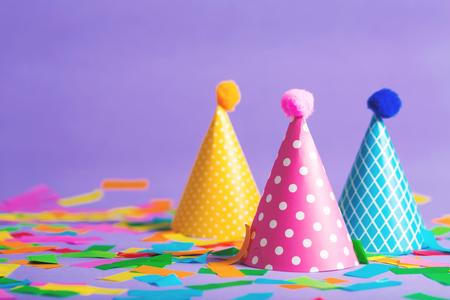 Party hat celebration theme with confetti on a bright background Archivio Fotografico