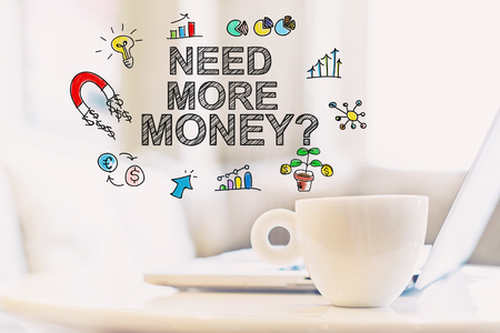 Need More Money concept with a cup of coffee and a laptop