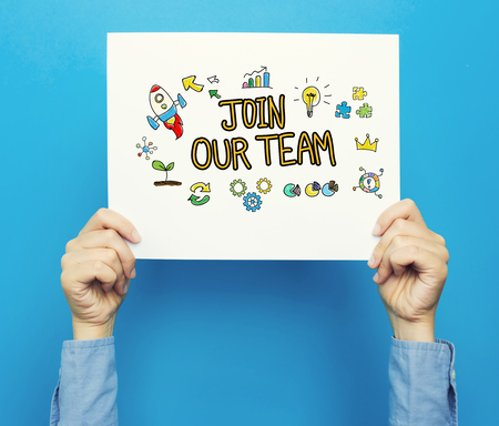 Join Our Team text on a white poster on a blue background Stock Photo