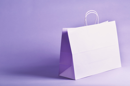 Purple gift bag on a solid vibrant background