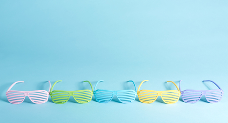 Shutter shades party glassess on a bright background