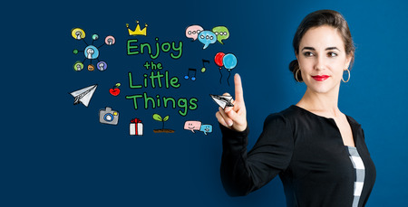 Enjoy The Little Thing text with business woman on a dark blue background Banco de Imagens