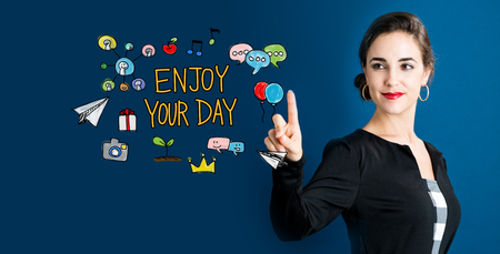Enjoy Your Day text with business woman on a dark blue background