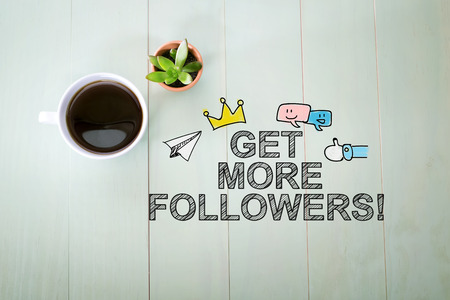 Get More Followers concept with a cup of coffee on a pastel green wooden table