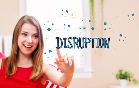disruptive: Disruption concept with young woman in her home Stock Photo