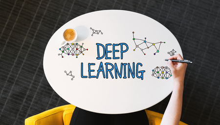 Deep Learning text on a white table with persons hand Фото со стока