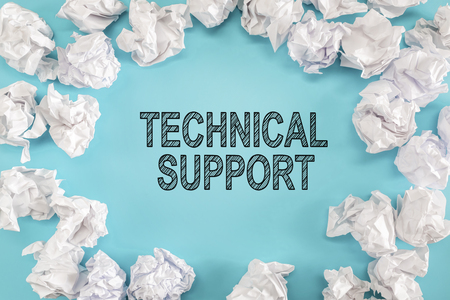 Technical Support text with crumpled paper balls on a blue background
