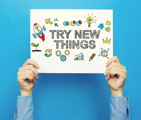 Try New Things text on a white poster on a blue background