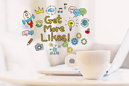 Get More Likes concept with a cup of coffee and a laptop Reklamní fotografie