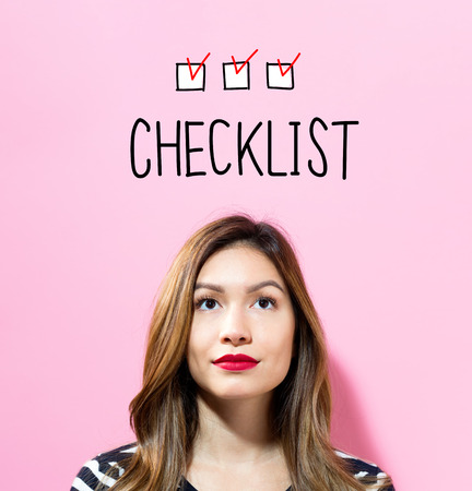 Checklist text with young woman on a pink background