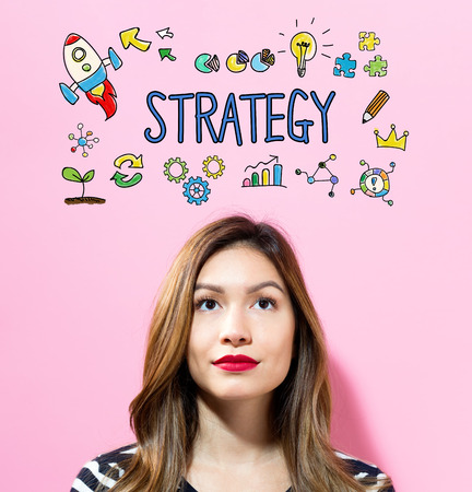 Strategy text with young woman on a pink background Banco de Imagens