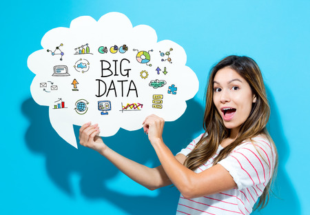 Big Data text with young woman holding a speech bubble Imagens