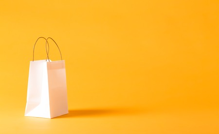 Gift bag on a yellow background Stok Fotoğraf