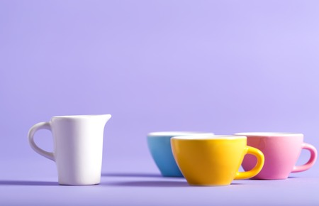 Little teacups on a bright background