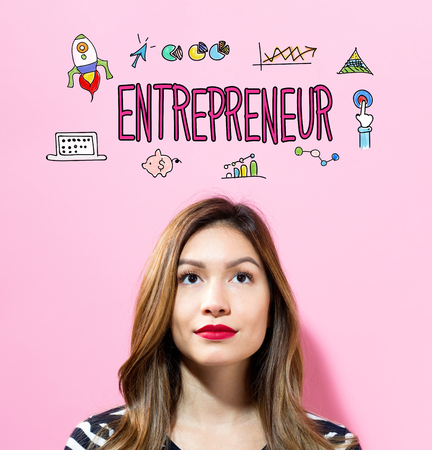 Entrepreneur text with young woman on a pink background Imagens