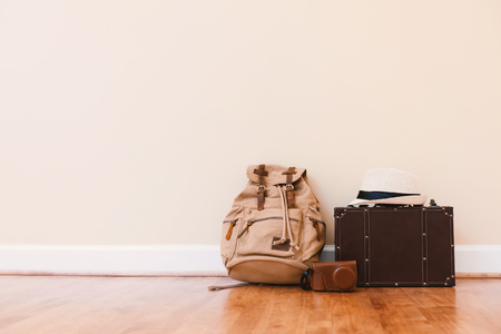 Packing a suitcase and backpack for a trip