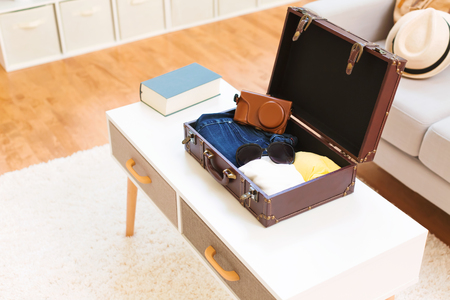 Packing a clothes and accessories in a suitcase for a trip
