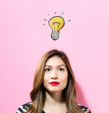 Light Bulb with young woman on a pink background